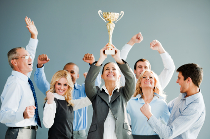 Cheerful group of businesspeople winning the cup.